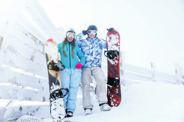 Young couple at snowy resort. Winter vacation