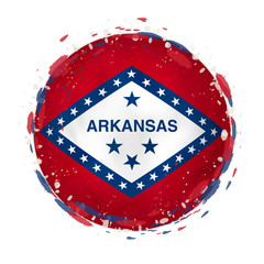 Round grunge flag of Arkansas US state with splashes in flag color.