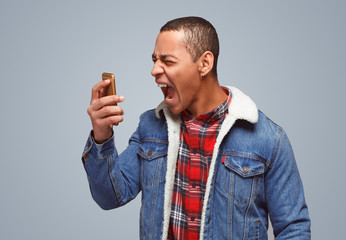 Screaming man with phone in rage