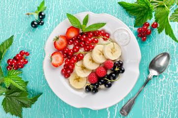 Oatmeal porridge with berries for breakfast