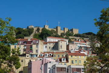 External View of Sao Jorge Castle in Lisbon and Colorful Houses Underneath it, Portugal