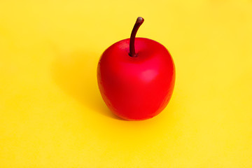 Decoration - red apple on a yellow background