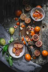 Overhead view of blood oranges on cutting board