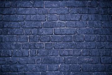 Grunge dark concrete background with imitation brickwork.