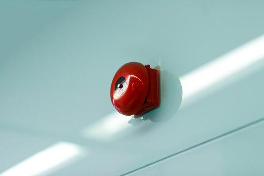 Alarm bell on wall