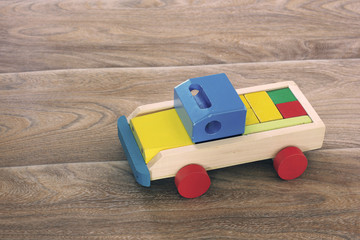 Wooden Toys. For children. Old toys on a wooden background