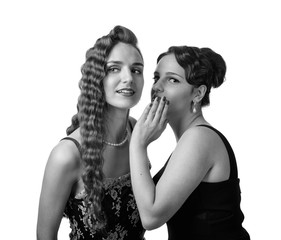 Two young women whispering gossip on white background.