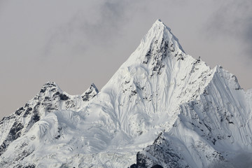 View of Meili Snow Mountain against cloudy sky