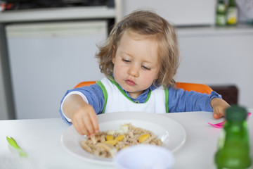 Girl eating noodle with hand