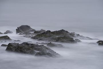 Ocean Waves Over Rocks at Cliff Walk in Rhode Island