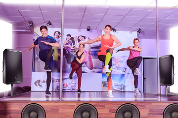 trainers on the stage at fitness workout
