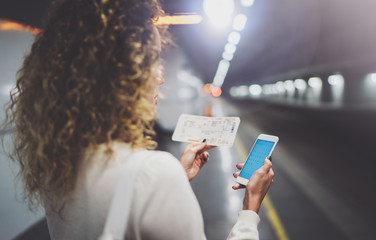 Beautiful girl happy using mobile phone app for conversation in holiday travel.Attractive woman on transit platform using smartphone while waiting rail train on station.