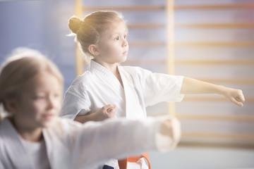 Girl in kimono practising karate