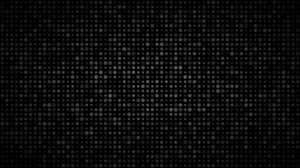 Abstract dark background of small circles in various sizes in shades of black and gray colors.