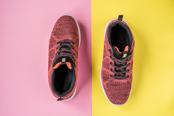 Sneakers on a yellow and pink background top view