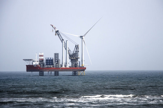 The largest wind farm installation vessel in the world and the first turbine installed off the coast of Aberdeen. Balmedie, Aberdeenshire, Scotland, UK. April 11th 2018