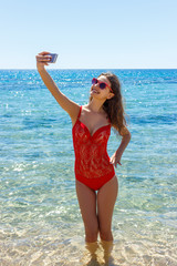 picture of happy smiling woman using phone camera and making selfie