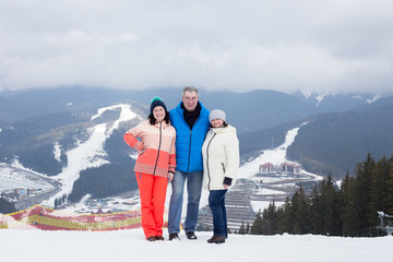 Daughter with parents at the top of the mountain.