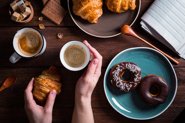 Hands with coffee and sweets