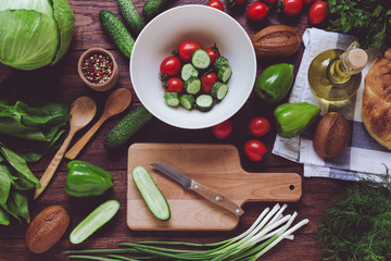 Assortment of vegetables and wooden board