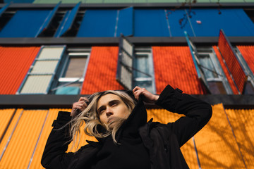Low angle view of woman standing against colorful building