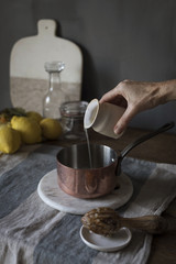 Hand pouring lemon juice