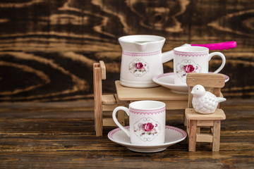 Decorative Colorful Porcelain Coffee set on Wooden Background