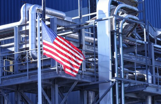 American Flag flying in front of manufacturing factory