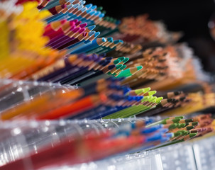 Image of multicolored pencils in plastic boxes
