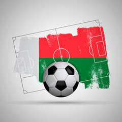 Madagascar flag soccer background with grunge flag, football pitch and soccer ball