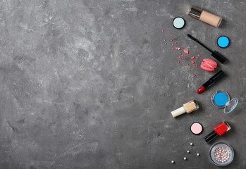 Flat lay composition with professional makeup products on grey background