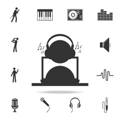 man listening music with headphones and a laptop icon. Detailed set of music icons. Premium quality graphic design. One of the collection icons for websites; web design; mobile app