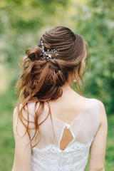 disheveled hairstyle on the bride with a small barrette view from behind