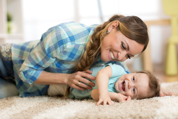 Mother with baby having a fun pastime at home