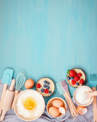 Zelfklevend Fotobehang Koken Baking utensils and cooking ingredients for tarts, cookies, dough and pastry. Flat lay with eggs, flour, sugar, berries.Top view, mockup for recipe, culinary classes, cooking blog.