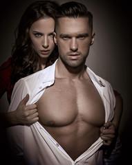 Pretty lady seducing a handsome busineesman