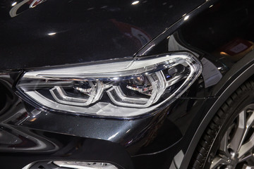 Close up of detail on one of the LED headlights modern and luxury car. Select focus.