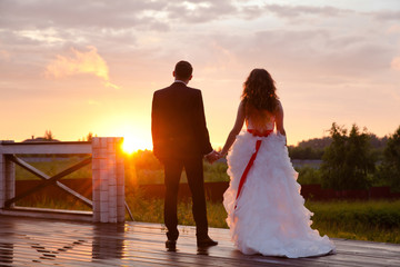 the couple looks at the evening sun