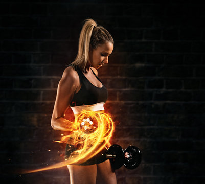 Attractive young blond woman doing bodybuilding