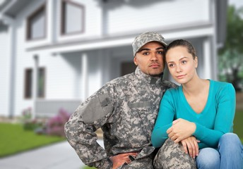 Smiling soldier with his wife