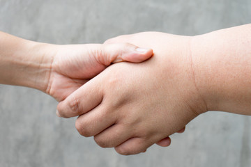 Business partnership meeting concept. Image business man handshake. Successful businessmen handshaking after good deal. Horizontal, big hand and small hand