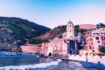Scenic view of the  summer Vernazza - one of five famous villages of Cinque Terre National Park in Liguria, Italy, suspended between Ligurian sea and land on sheer cliffs