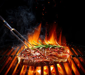 Poster Grill / Barbecue Entrecote Beef Steak On Grill With Rosemary Pepper And Salt