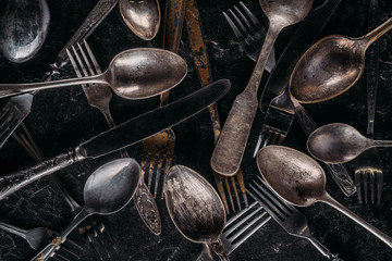 Vintage cutlery set on dark background