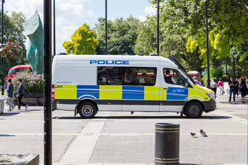 Metropolitan Police van with police officer inside at Marble Arch, London