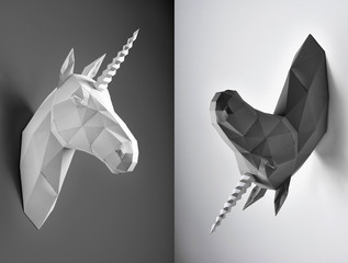 Contrast weird wto parts collage of black and white unicorn heads. Horses have similiar geometrical lines and shape with angles. Unicorns hang on white and black background.