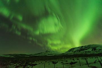 Aurora polaris above mountains at north iceland in winter.northern lights landscape