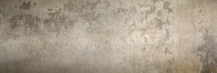 Textur einer schönen, alten Betonwand als Hintergrund, auf die etwas Sonnenlicht fällt