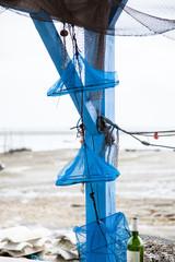 Cestas para la pesca de Ostras de color azul.
