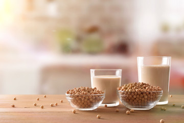 Reptientes with soy milk and grains in rustic kitchen front